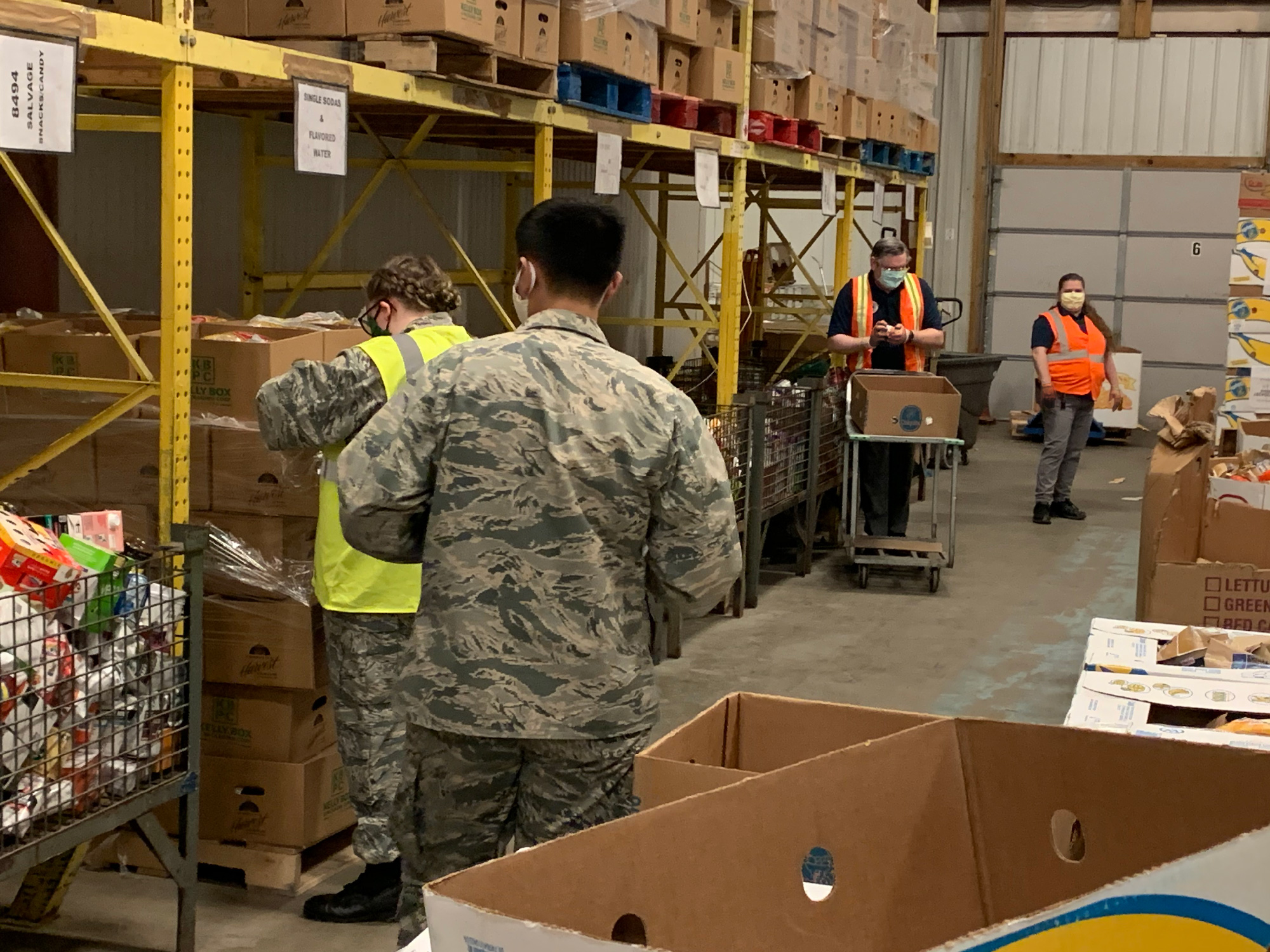 Civil Air Patrol members stock shelves at Community Harvest Food Bank.